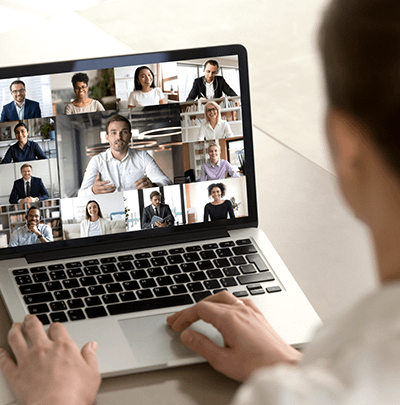 Laptop user connected to users via video conference