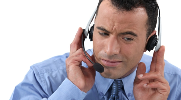 Man listening on phone headset.